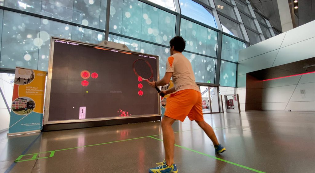 Tennis Player training cardio fitness on MultiBall
