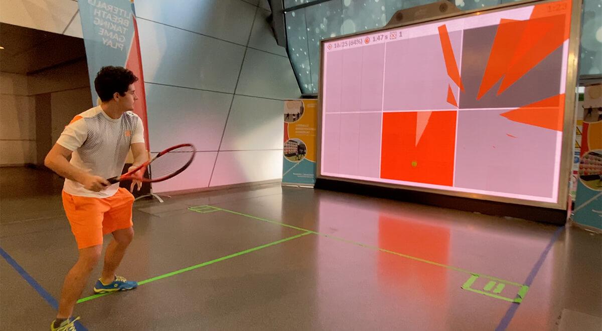 Tennis Player training hand-eye-coordination on MultiBall